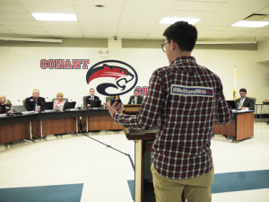 A student testifies before the District 211 school board.
